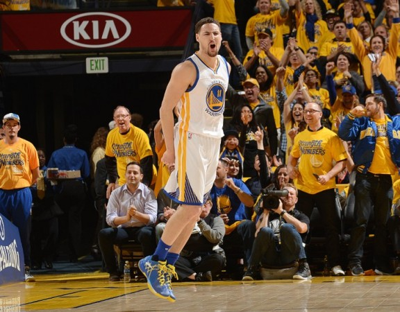 OAKLAND, CA - APRIL 27:  Klay Thompson #11 of the Golden State Warriors celebrates during the game against the Houston Rockets in Game Five of the Western Conference Quarterfinals during the 2016 NBA Playoffs on April 27, 2016 at ORACLE Arena in Oakland, California. NOTE TO USER: User expressly acknowledges and agrees that, by downloading and or using this photograph, user is consenting to the terms and conditions of Getty Images License Agreement. Mandatory Copyright Notice: Copyright 2016 NBAE (Photo by Noah Graham/NBAE via Getty Images)